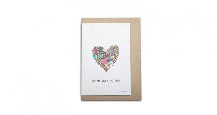 Gave med mening: Kort fra Growing Paper. You are such a Sweetheart. Hvit bakgrunn. Foto.