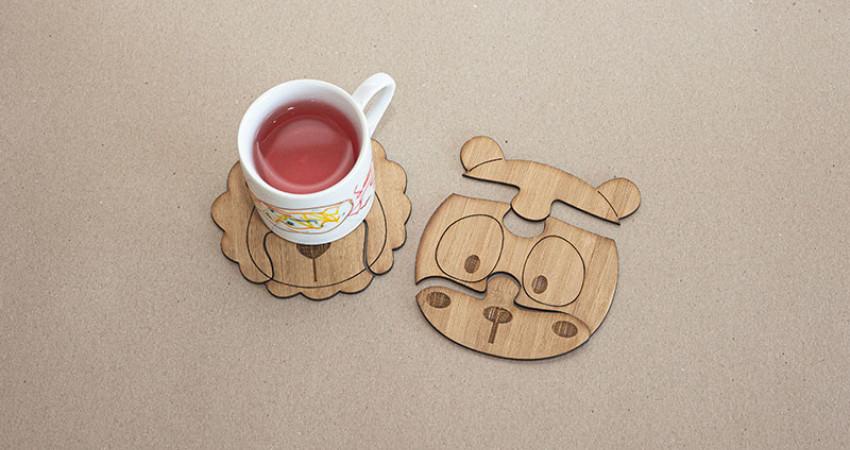 Gave med mening: Koppebrikker til barn, panda og løve. Med kopp. Foto.